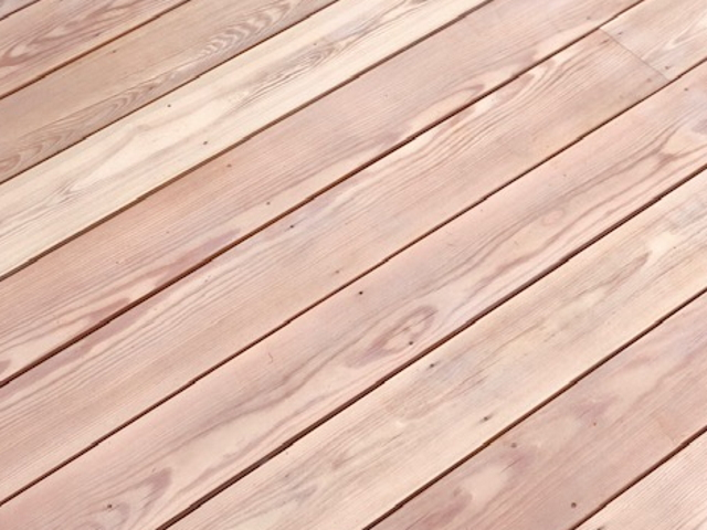 25 Osmo Uv oil on larch decking