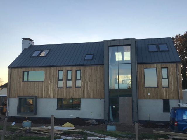 28 Co2 Larch® Shadow Gap House Clad in Larch